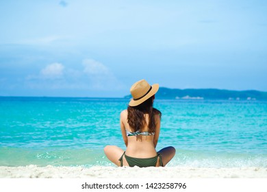 Happy young woman in bikini enjoy summer vacation on the tropical beach.