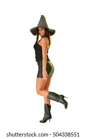 happy young woman in black witch halloween costumes