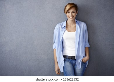Happy young woman in casual clothes, smiling