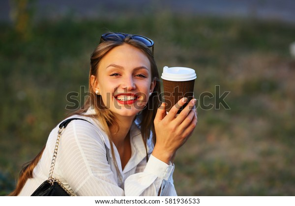 Happy young woman with coffee