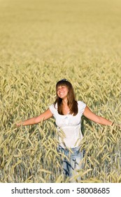 Happy young woman in corn field enjoy sunset on sunny day