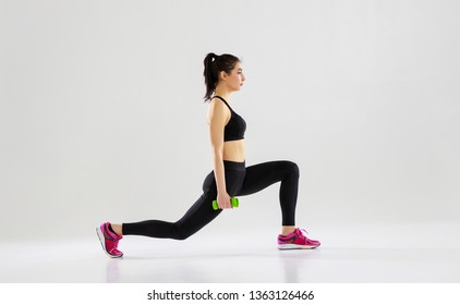 happy young woman doing fitness sports on white background