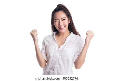 Happy young woman doing  victory sign, isolated on white background