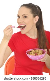 Happy Young Woman Eating Breakfast Cereal