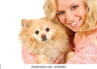 A happy young woman embracing her pomeranian.