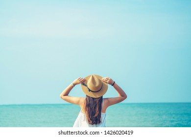 Happy young woman enjoy summer vacation on the beach.