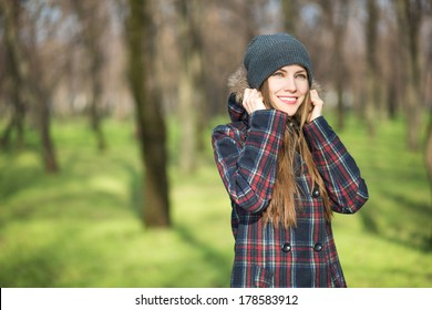 Happy young woman enjoying early spring sunshine