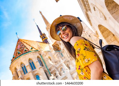 A happy young woman enjoying her trip to the Castle of Budapest in Hungary.