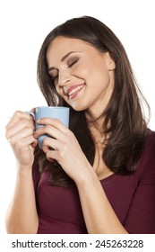 happy young woman enjoying the smell of morning coffee