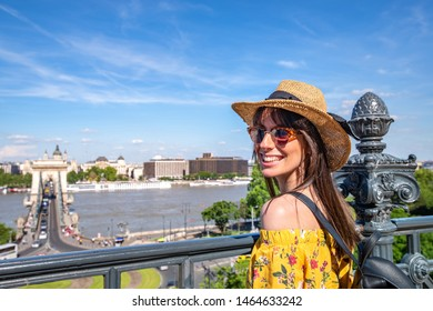 A happy young woman enjoying the view over Budapest in Hungary.