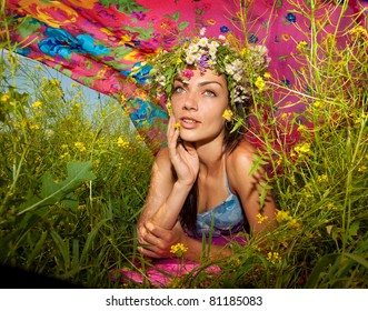 Happy young woman in flowers