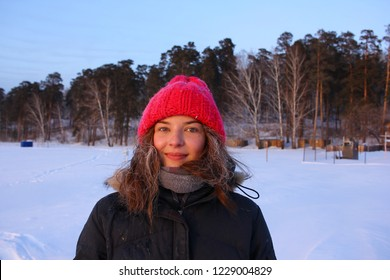 Happy young woman with frost on face