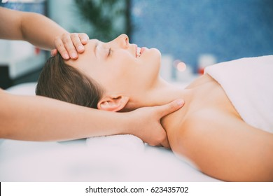 Happy Young Woman Getting Spa Treatment in Salon
