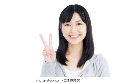 3f972ecc6 happy young woman in grey hoodie showing V sign