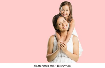 Happy young woman have fun with cute child baby girl.