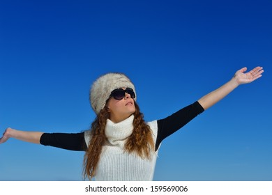 happy young woman having fun at winter nature landscape with fresh snow