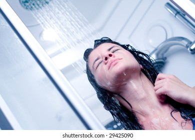 Happy young woman having a shower