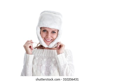 Happy young woman in heat winter sweater and fur hat