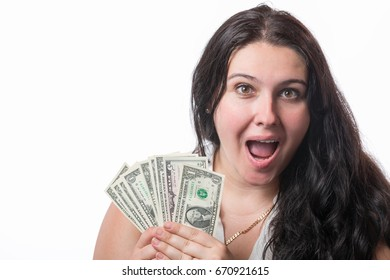 Happy young woman holding american dollar money with opened mouth joy isolated on white. Positive emotions concept.