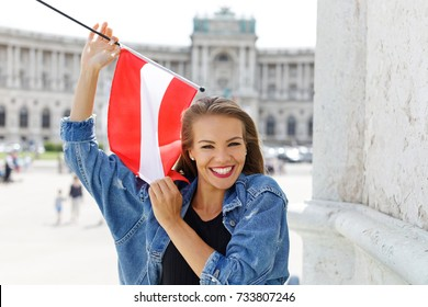 Happy young woman holding austrian flag in Vienna, Austria