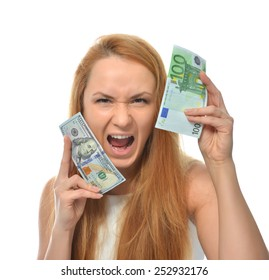 Happy young woman holding up cash money one hundred euro in one hand and dollars in other compare thinking looking at the corner isolated on a white background