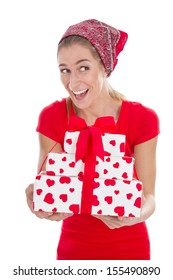 Happy young woman holding gift boxes with red hearts isolated over white.
