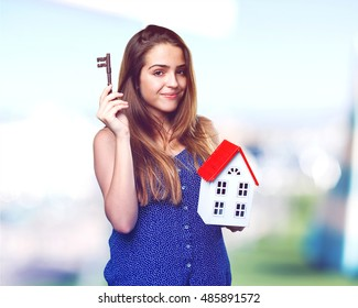 happy young woman holding a house and a key