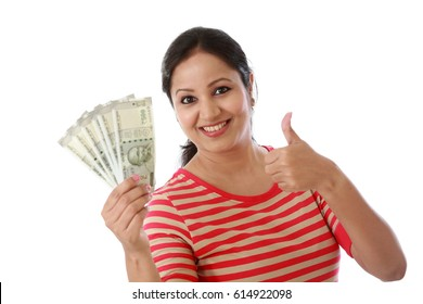 Happy young woman holding Indian 500 rupee notes