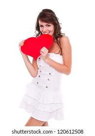 Happy young woman holding red heart in hand over white background