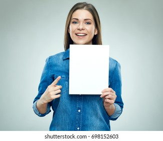 Happy young woman holding sign board pointing finger on copy space. Isolated portrait.