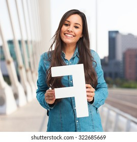 happy young woman with letter f