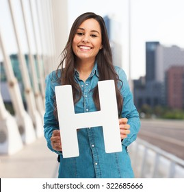 happy young woman with letter h