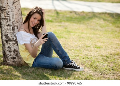 happy young woman looking at her phone