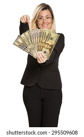 Happy young woman with money. Saving account concept.