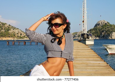 Happy young woman on the sea
