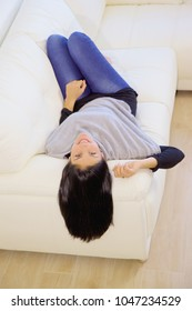 Happy young woman on sofa