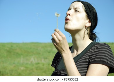 happy young woman outdoors in summer