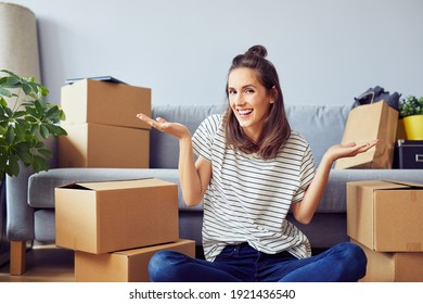 Happy young woman posing in new apartment during moving in