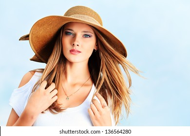 Happy young woman posing outdoor over blue sky.