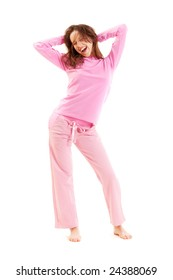 happy young woman in pyjamas at the morning