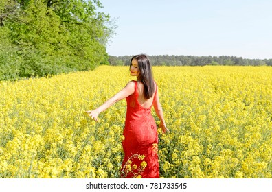 happy young woman  in the rape field