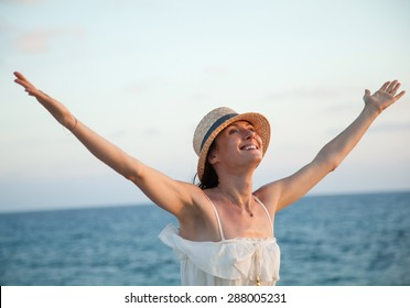 Happy young woman  rejoices at summer vacation