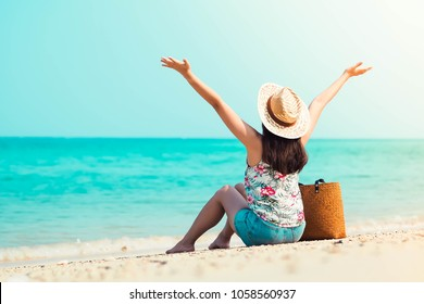 Happy young woman relax on the beach. Woman on the beach. Travel vacation in the summer