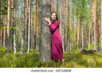 Happy young woman relaxing in the forest.