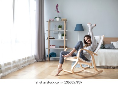 Happy young woman relaxing at home. Good weekend.