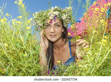 Happy young woman resting in a field