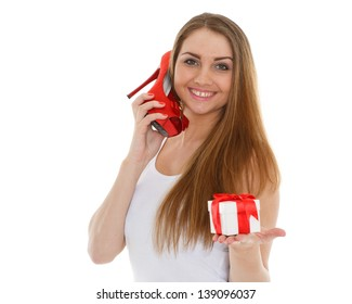 Happy young woman with shoe and gift box on a white background. Sale.