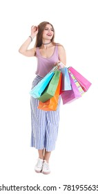 Happy young woman with shopping bags on white background