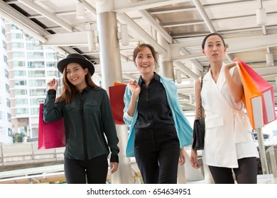Happy young woman shopping in holidays.