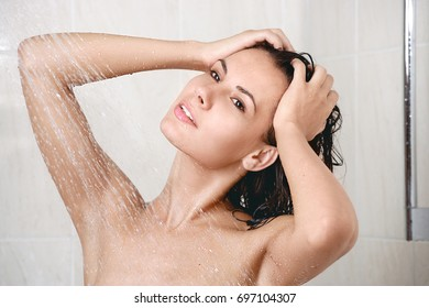 happy young woman in shower